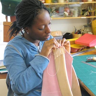 Student hand stitching