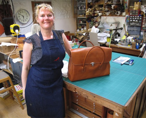 Student with leather bag, made on a leatherwork course
